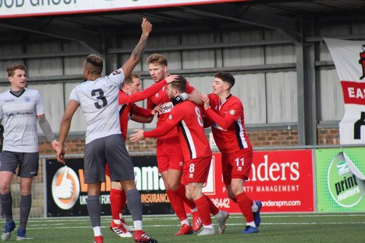 EB Ox City 2-19 Goalscorer Charlie Walker (8) celebrates his opening goal while Oxford defenders appeal in vain for offside